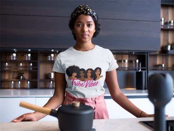 woman wearing a round neck tshirt mockup while in her kitchen counter