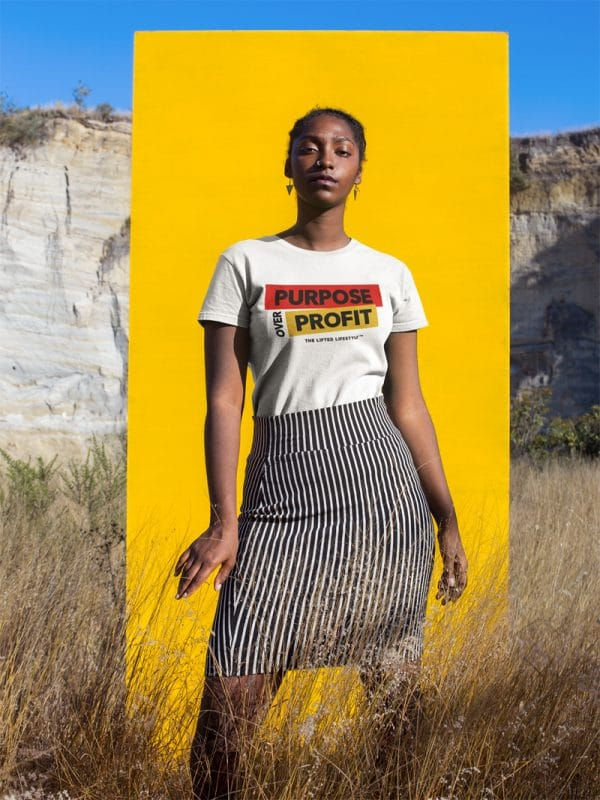 beautiful woman standing against a yellow rectangle wearing a tshirt mockup