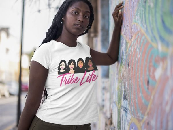 black girl lying against a colorful wall wearing a round neck tee mockup