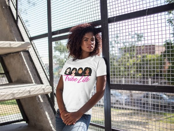 black girl wearing a tshirt mockup while lying against a fence