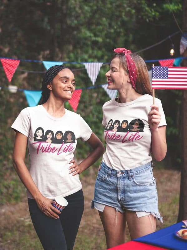 interracial pair of friends wearing tshirts mockup at a 4th of july bbq party