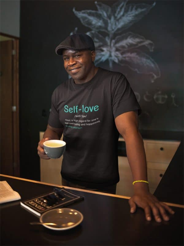 mockup of a black man wearing a t shirt and a beret having a coffee a21423jpg 800px 2