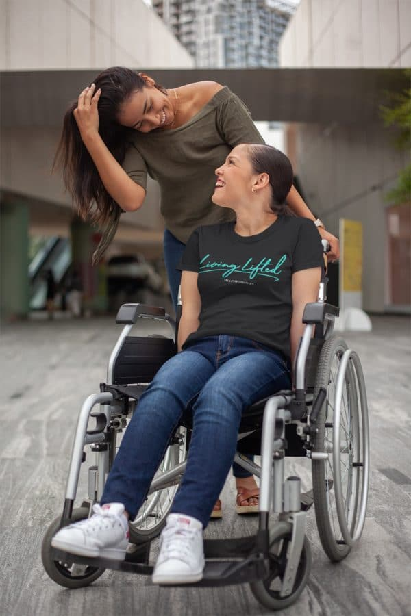 mockup of a girl using a wheelchair while wearing a tshirt with her friend