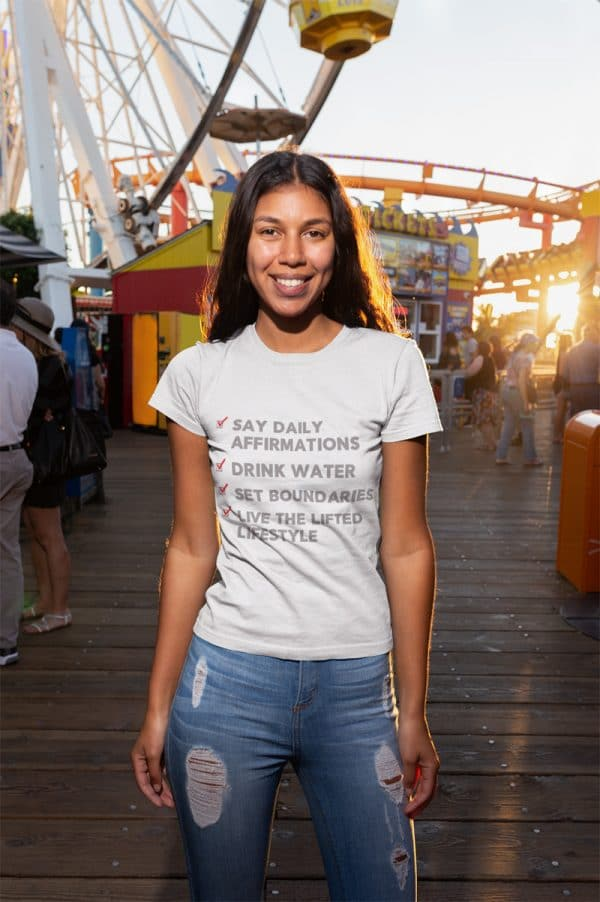 mockup of a smiling girl wearing a tshirt at an amusement park