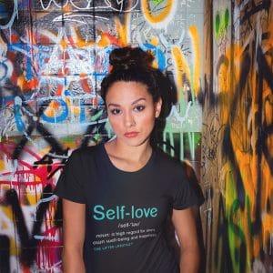 tshirt mockup of a girl in a bathroom with graffiti 22279jpg 800px