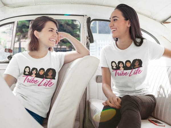 two happy girls talking while wearing different tees template inside a white car